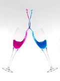 Pop Art Celebration. Two champagne glasses clinking and mixing liquids royalty free stock photos