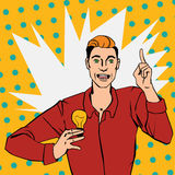 Pop art comic style illustration with man showing lamp. Vector illustration of man with lamp showing finger up and says idea in pop art comic style Stock Image