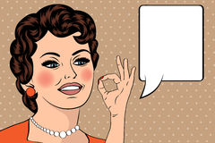 Pop art cute retro woman in comics style with OK sign Royalty Free Stock Photos