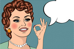 Pop art cute retro woman in comics style with OK sign Royalty Free Stock Photography