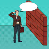 Pop Art Doubtful Businessman Standing in Front of a Brick Wall Royalty Free Stock Image