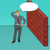 Pop Art Doubtful Businessman Standing in Front of a Brick Wall Stock Photography