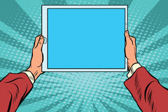 Pop art electronic tablet in the hands Royalty Free Stock Image