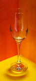 Pop art. Empty champagne glass on colorful background. Clipping path royalty free stock photo