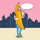 Pop Art Female Promoter with Advertising Flyers. Woman in Banana Costume. Teenage Cheerful Girl Promoting Something Royalty Free Stock Photo