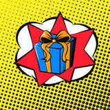 Pop art gift. Background in the style of pop art with a surprise gift Stock Images