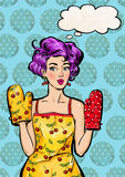 Pop Art girl in apron  and oven mitts with the speech bubble. Royalty Free Stock Photography