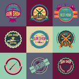 Pop art gun shop logotypes and badges vector set Royalty Free Stock Images