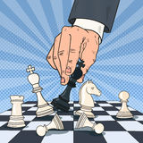 Pop Art Hand of Businessman Playing Chess. Business Strategy Concept. Vector illustration Stock Photos