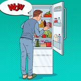 Pop Art Happy Man Looking Inside Fridge Full of Food. Guy with Refrigerator with Dairy Products Stock Photography