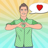 Pop Art Happy Man Showing Heart Hand Sign. Love Comic Style Background. Vector illustration Royalty Free Stock Image