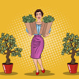 Pop Art Happy Rich Woman Holding Bags with Money Stock Photo