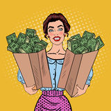 Pop Art Happy Rich Woman Holding Bags with Money Stock Photos