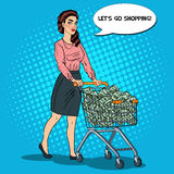 Pop Art Happy Rich Woman with Shopping Cart Full of Money Royalty Free Stock Images