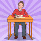 Pop Art Happy Schoolboy Sitting at School Desk. Education Concept Royalty Free Stock Images