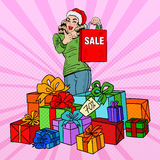 Pop Art Happy Woman in Santa Hat with Shopping Bag and Huge Gift Boxes on Christmas Sale Stock Images