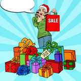 Pop Art Happy Woman in Santa Hat with Shopping Bag and Huge Gift Boxes on Christmas Sale Stock Image