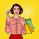 Pop Art Happy Woman with Shopping Bags and Credit Card. Seasonal Sale Royalty Free Stock Images