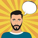 Pop art male portrait with blank speech bubble. Comic man at sunburst background with dot halftone effect. Vector. Royalty Free Stock Image