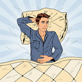 Pop Art Man in Bed Suffering Insomnia and Sleeplessness. Vector illustration Stock Photos
