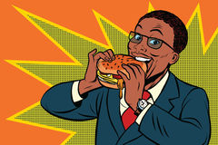 Pop art man eating a Burger Stock Photo
