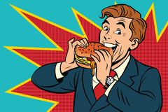 Pop art man eating a Burger. Retro comic book vector illustration. The fast food advertising. Promo people Stock Photos