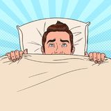 Pop Art Man Hiding in Bed. Scared Guy Peeps Up Under the Blanket Royalty Free Stock Photography