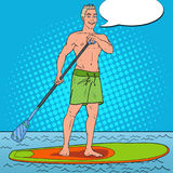 Pop Art Man Paddling on Stand Up Paddle Board. SUP Watersport on the Sea. Vector illustration Stock Photos