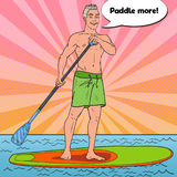 Pop Art Man Paddling on Stand Up Paddle Board. SUP Watersport on the Sea Royalty Free Stock Photography