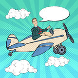 Pop Art Man Riding Retro Airplane with Comic Speech Bubble. Vector illustration Royalty Free Stock Image