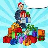 Pop Art Man in Santa Hat with Gifts on Christmas Sale Royalty Free Stock Image