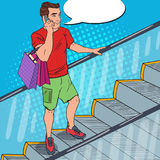 Pop Art Man with Smartphone and Shopping Bags on Escalator. Vector illustration Royalty Free Stock Image