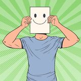 Pop Art Man with Smiley Emoticon on Paper Sheet. Happy Guy Holding a Smiling Face Emoticon Stock Photo