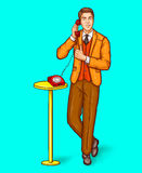 Pop art man talking on a retro phone and shows the thumbs up stock illustration
