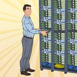 Pop Art Network Engineer Working with Hardware Data Center.. Build Server Database. Technicianin Server Room. Vector illustration Royalty Free Stock Photo