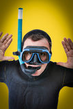 Pop art portrait of a diver. Yellow background Royalty Free Stock Photography
