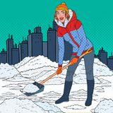 Pop Art Pretty Woman Clearing Snow with Shovel. Winter Snowfall in the City. Vector illustration royalty free illustration