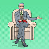 Pop Art Senior Businessman Sitting in Chair and Pointing Copy Space Stock Image