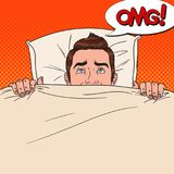 Pop Art Shocked Man Hiding in Bed. Scared Guy Peeps Up Under the Blanket Royalty Free Stock Images
