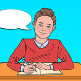 Pop Art Smiling Schoolboy Sitting at School Desk. Educational Concept Stock Image