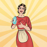 Pop Art Smiling Woman Housewife Holding Detergent Bottle and Showing Thumb Up Royalty Free Stock Photos