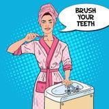 Pop Art Smiling Young Woman Brushing Teeth in Bathroom. Dental Hygiene Stock Photo