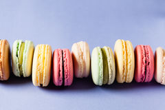 Pop art still life. With colorfull macaroons on blue background Stock Photography