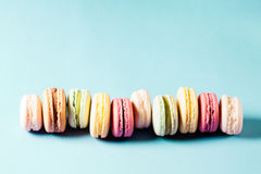 Pop art still life. With colorfull macaroons on blue background Royalty Free Stock Photo