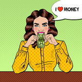 Pop Art Successful Beautiful Woman Eating Money Royalty Free Stock Photos