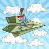 Pop Art Successful Businessman Flying on Dollar Paper Plane Royalty Free Stock Images
