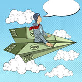 Pop Art Successful Businessman Flying on Dollar Paper Plane Stock Images