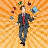 Pop Art Successful Businessman Juggling Computer, Phone and Money Royalty Free Stock Images