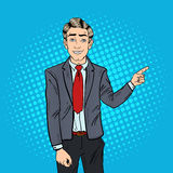 Pop Art Successful Businessman Pointing Finger on Copy Space. Business Presentation Royalty Free Stock Photo