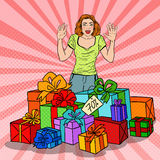 Pop Art Surprised Woman with Huge Gift Boxes. Vector illustration Stock Photo